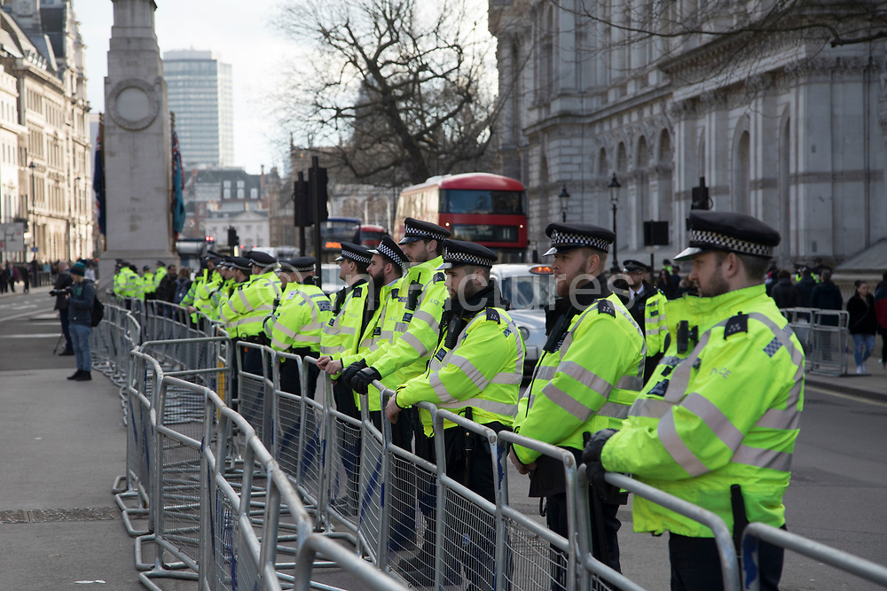 Police lines grow in numbers as a demonstration on Whitehall against Saudi Crown Prince Mohammad Bin Salman official visit to the UK on 7th March 2018 in London, United Kingdom. Mohammad bin Salman started his visit to the UK with the Conservative Party and royal family rolling out the red carpet for Saudi Arabias crown prince as opposition politicians and rights groups call on the British Prime Minister to use the trip to challenge the kingdoms record on human rights. Campaigners accuse Mohammad bin Salman of being the 'chief architect' of the Yemen war, which has led to what the U.N.  describes as the worlds worst humanitarian crisis.