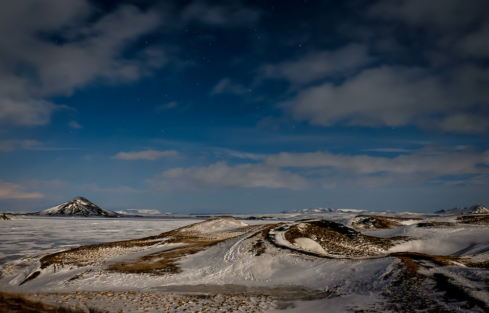 MÝVATN, ICELAND - CIRCA MARCH 2015: Frozen Mývatn lake at night during winter time. This is a popular tourist destination in Iceland.