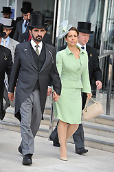 H.H. Sheikh Mohammed bin Rashid Al Maktoum and Princess Haya bint al-Hussein of Jordan at the Investec Derby at Epsom Racecourse, Epsom Downs, Surrey on 4th June 2011.