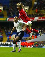 Photograph: Scott Heavey.<br />Tottenham Hotspur v Middlesbrough. FA Barclaycard Premiership. 26/10/2003.<br />Boudewijn Zenden out-jumps Stephen Carr