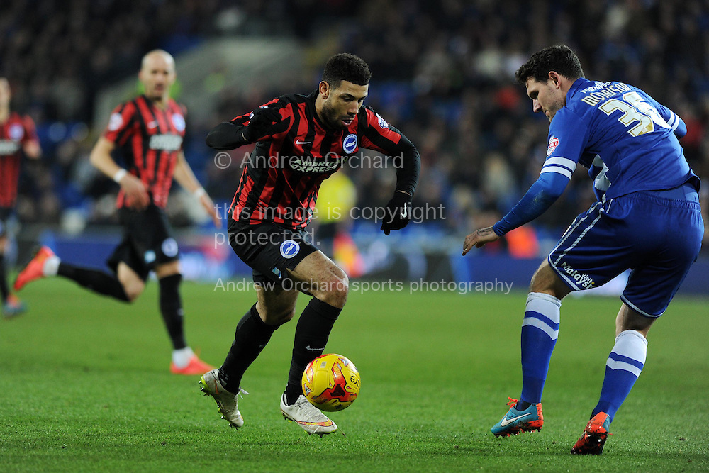 Leon Best of Brighton looks to go past Cardiff's Sean Morrison. Skybet football league championship match, Cardiff city v Brighton & Hove Albion at the Cardiff city Stadium in Cardiff, South Wales on Tuesday 10th Feb 2015.<br /> pic by Andrew Orchard, Andrew Orchard sports photography.