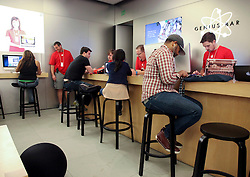23 November 2012. New Orleans, Louisiana,  USA. <br /> Black Friday. The Genius Bar is busy as shoppers descend on discounted iPhones, iPads, computers and accessories at the Apple Store on the traditional post Thanksgiving shopping frenzy.<br /> Photo; Charlie Varley/varleypix.com