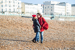 © Licensed to London News Pictures. 01/02/2020. Brighton, UK. Members of the public take to the beach in Brighton and Hove as sunny and milder weather is hitting the seaside resort. <br /> Photo credit: Hugo Michiels/LNP