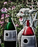 Bird housess, conventional and improvised from lobster pot marker buoys, are sold with gargoyles along the roadside in Maine.