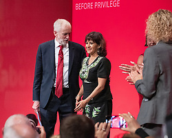 © Licensed to London News Pictures . 24/09/2019. Brighton, UK. Labour leader JEREMY CORBYN and his wife LAURA ALVAREZ share the stage after Corbyn delivers the leader's speech a day early , on the fourth day of the 2019 Labour Party Conference from the Brighton Centre , after the Supreme Court ruled that Boris Johnson's suspension of Parliament was unlawful . Photo credit: Joel Goodman/LNP