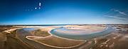 Nederland, Noord-Holland, Texel, 30-03-2021; De Slufter en Sluftervallei. In de achtergrond strand en zee. De duinvallei staat door middel van een gat in de duinen in open verbinding met de Noordzee, kreken zorgen voor de aan- en afvoer van het zeewater. Het gebied is onderdeel van hetNationaal Park Duinen van Texel en eigendom vanStaatsbosbeheer.<br /> De Slufter and Sluftervallei. The dune valley has an open connection with the North Sea, creeks provide the supply and discharge of the seawater. The area is part of the Duinen van Texel National Park.<br /> <br /> drone-opname (luchtopname, toeslag op standaard tarieven);<br /> drone recording (aerial, additional fee required);<br /> copyright foto/photo © 2021 Siebe Swart