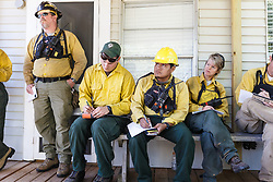 Fire specialists meeting before lighting prescribed burn on the Blackland Prairie at Clymer Meadow Preserve, Texas Nature Conservancy, Greenville, Texas, USA.