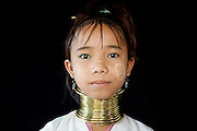 Women of the Paudang traditionally stretch their necks over time by adding brass rings, which then can no longer be taken off. Here a young girl wears the rings for decoration only, as the tradition is no longer widely practiced, largely due to health reasons. Ywa Ma village in Inle Lake, Shan state, Myanmar