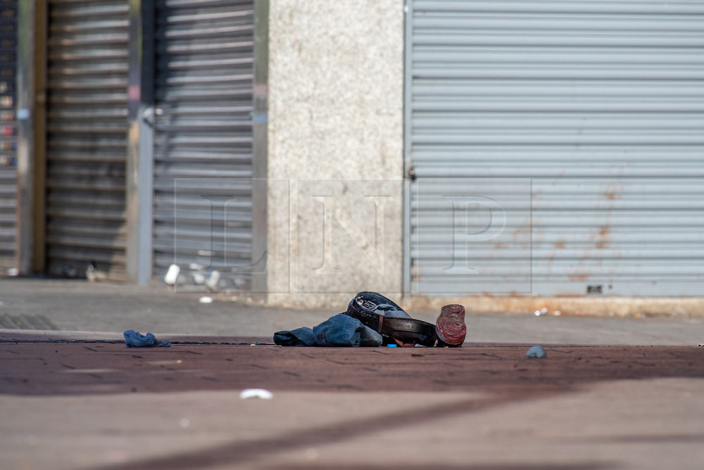 © Licensed to London News Pictures. 23/09/2019. London, UK. Items of clothing lay in situ at the scene where a man in his 20's was found injured outside a shop in The Broadway, Southall. The man was taken to hospital suffering from a stab injury; he we was pronounced dead at 05:26 BST. Photo credit: Peter Manning/LNP