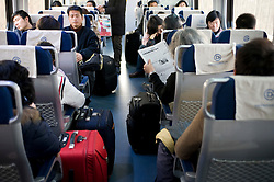Interior of busy new Airport Express train on route between central Beijing and new Beijing International airport China