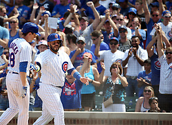 August 20, 2017 - Chicago, IL, USA - Chicago Cubs starting pitcher Kyle Hendricks (28) and catcher Rene Rivera score in the third inning against the Toronto Blue Jays on Sunday, Aug. 20, 2017 at Wrigley Field in Chicago, Ill. (Credit Image: © Brian Cassella/TNS via ZUMA Wire)