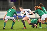 England player Emily Scarrett is tackled by the Irish defence in the first half during the Women's 6 Nations match between Ireland Women and England Women at Energia Park, Dublin, Ireland on 1 February 2019.