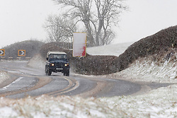 © Licensed to London News Pictures. 30/01/2021. Llanfihangel Nant Melan, Powys, Wales, UK. A 4WD vehicle negotiates the A44 road in blizzard conditions near Llanfihangel nant Melan in Powys, Wales, UK. Photo credit: Graham M. Lawrence/LNP