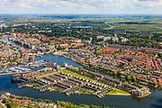Nederland, Noord-Holland, Zaandam, 14-06-2012; Overzicht Zaandam met Zaaneiland in de voorgrond. Het eiland is gelegen in de monding van rivier de Zaan, tussen Voorzaan en de Oude Haven. Vroeger ingebruik bij de houtindustrie, o.a. houtwerven. Nieuwe woonwijk op eiland, waterstad. <br /> Overview on Zaandam with new residential area on former industrial area on island on the river Zaan.<br /> luchtfoto (toeslag), aerial photo (additional fee required)<br /> foto/photo Siebe Swart