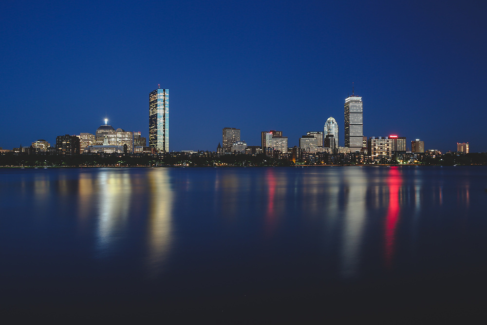 Boston's Back Bay skyline glowing on a summer evening.