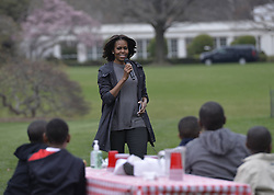 61337999<br /> U.S. First Lady Michelle Obama speaks in the White House Kitchen Garden on the South Lawn of the White House in Washington D.C., capital of the United States, April 2, 2014. U.S. First Lady Michelle Obama joined FoodCorps leaders and local students to plant the White House Kitchen Garden for the sixth year in a row, USA,  Wednesday, 2nd April 2014. Picture by  imago / i-Images<br /> UK ONLY