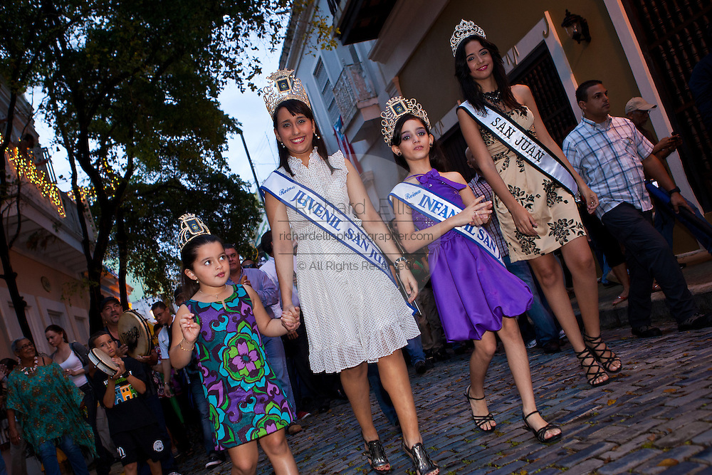 San Juan beauty contest winners march in a parade through the streets of Old San Juan during the Festival of San Sebastian in San Juan, Puerto Rico.