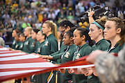 April 4, 2016; Indianapolis, Ind.; The UAA women's basketball team holds a section of the American flag during the national anthem in the NCAA Division II Women's Basketball National Championship game at Bankers Life Fieldhouse between UAA and Lubbock Christian. The Seawolves lost to the Lady Chaps 78-73.