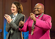 Former archbishop Desmond Tutu dances alongside Heather Templeton Dill, granddaughter of the late Sir John Templeton at a ceremony after receiving the 2013 Templeton Prize at the Guildhall in London, UK. South African anti-apartheid campaigner Desmond Tutu won the 2013 Templeton Prize worth $1.7 million for helping inspire people around the world by promoting forgiveness and justice.