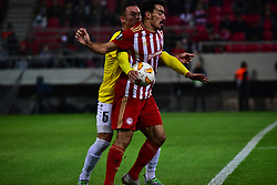November 8, 2018 - Athens, Attiki, Greece - Lazaros Christodoulopoulos (no 11) of Olympiacos, tries to control the ball, despite the pressure of Tom Schnell (no 5) of F91 Dudelange..Olympiacos has won F91 Dudelange 5-1 for the UEFA Europa League. (Credit Image: © Dimitrios Karvountzis/Pacific Press via ZUMA Wire)