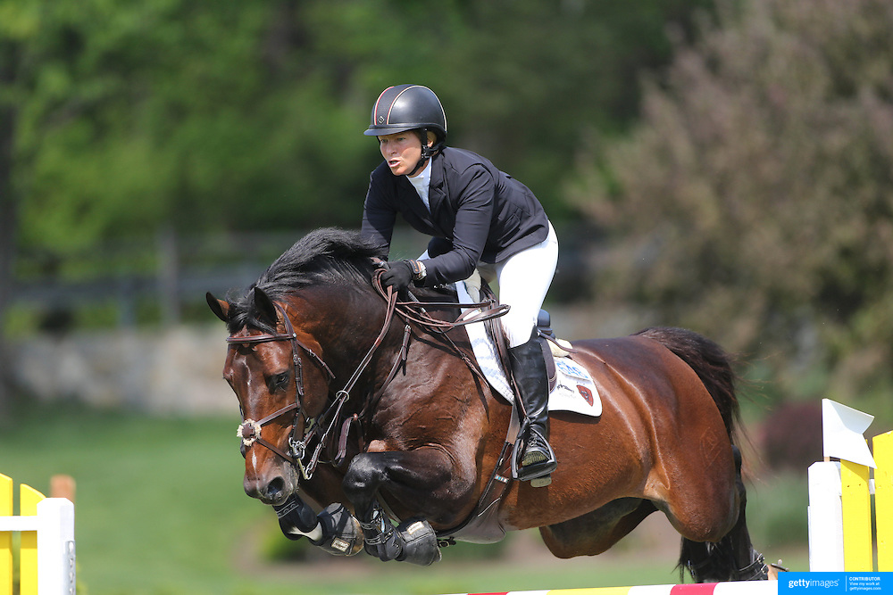Beezie Madden riding Breitling LS in action during the $100,000 Empire State Grand Prix presented by the Kincade Group during the Old Salem Farm Spring Horse Show, North Salem, New York,  USA. 17th May 2015. Photo Tim Clayton
