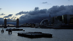 © Licensed to London News Pictures. 11/01/2014. The morning started with rain and with an ominous dark cloud. After a wet and cloudy start to the day, London saw bright sunshine and blue skies. Credit : Rob Powell/LNP