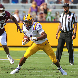 Sep 26, 2020; Baton Rouge, Louisiana, USA; LSU Tigers running back John Emery Jr. (4) runs against the Mississippi State Bulldogs during the first half at Tiger Stadium. Mandatory Credit: Derick E. Hingle-USA TODAY Sports