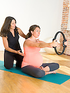 Pregnant woman (9 months) and trainer, strech and workout.