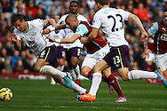 Everton's Phil Jagielka and Burnley's Michael Kightly chase the ball. Barclays Premier league match, Burnley v Everton at Turf Moor in Burnley, Lancs on Sunday 26th October 2014.<br /> pic by Chris Stading, Andrew Orchard sports photography.