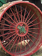 Closeup view of the spokes and wheel of an antique steam engine; Rock River Thresheree, Edgerton, Wisconsin; 2 Sept 2013