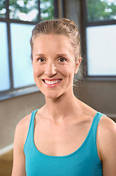 Portrait young smiling woman Yoga outfit wellness