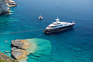 An aerial view of a luxury yacht moored off the coast of Paxos, The Ionian Islands, The Greek Islands, Greece, Europe