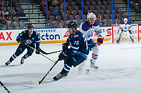 PENTICTON, CANADA - SEPTEMBER 9:  Austin Strand #80 of Edmonton Oilers checks Skyler McKenzie #76 of Winnipeg Jets on September 9, 2017 at the South Okanagan Event Centre in Penticton, British Columbia, Canada.  (Photo by Marissa Baecker/Shoot the Breeze)  *** Local Caption ***