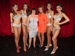 """© Licensed to London News Pictures . 26/06/2013 . Manchester , UK . Shameless actresses Alice Barry (3rd from left) and Kira Martin (3rd from right) pose with the Ladyboys during the interval . The Ladyboys of Bangkok perform their show , """" Glamorous Amorous """" at the Sabai Pavilion , in Manchester , as part of their 2013 UK tour . Photo credit : Joel Goodman/LNP"""