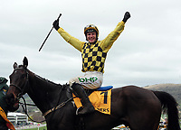 National Hunt Horse Racing - 2019 Cheltenham Festival - Friday, Day Four (Gold Cup Day)<br /> <br /> R Townsend on Al Boum Photo celebrates after crossing the finish line in the 15.30 Magners Cheltenham Gold Cup steeple chase at Cheltenham Racecourse.<br /> <br /> COLORSPORT/ANDREW COWIE