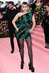 """Miley Cyrus at the 2019 Costume Institute Benefit Gala celebrating the opening of """"Camp: Notes on Fashion"""".<br />(The Metropolitan Museum of Art, NYC)"""