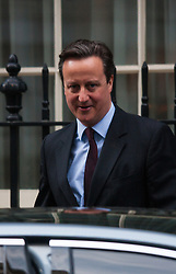 London, February 24th 2015. British Perime Minister David Cameron leaves 10 Downing Street on his way to the commons on the day of former Tory Foreign Secretary Malcolm Rifkind's resignation and suspension from the Conservative Party. The Prime minister remained tight-lipped when asked if Rifkin had embarrassed the Conservative Party.