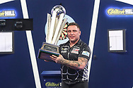 Gerwyn Price lifts the Sid Waddell Trophy during the William Hill World Darts Championship Final at Alexandra Palace, London, United Kingdom on 3 January 2021.