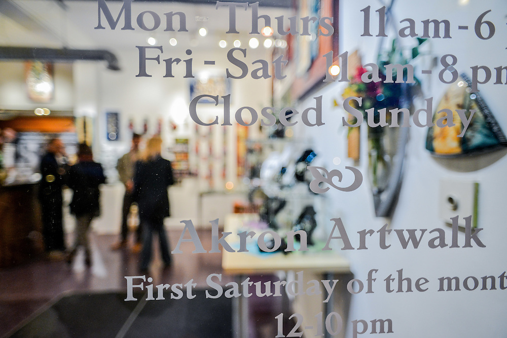 Business information on the front window at Zeber-Martell Clay Studio and Art Gallery.