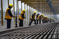 May 5, 2018 - Hubei, China - Workers lay tracks at the construction site of Wuhan-Shiyan high-speed railway in Zaoyang, central China's Hubei Province.  The 399-km-long line will operate in 2019. (Credit Image: © Du Huaju/Xinhua via ZUMA Wire)
