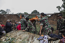February 6, 2018 - Cijeruk, Jakarta, Indonesia - Bogor, Maseng, Cijeruk, West Java : 06 February 2018 : 5 people were buried from landslide at Maseng-Cijeruk-Bogor-West Java. The landslide happen because heavy rain hit the area and poor construction of the rail way near the houses built below the rail way, causing three houses where 9 people live there, 5 were buried dead from the landslide. Police and Millitary try the evacation since 05 February but still failed to find the bodies. On 6 February 2018 by the help of good sniff from police K9 Dogs 5 bodies were found and managed evacuated. (Credit Image: © Donal Husni via ZUMA Wire)