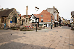 © Licensed to London News Pictures. 17/03/2020. Lincoln, Lincolnshire, UK. Deserted Lincoln. Pictured, The High Street and usually busy shopping centre. The streets leading from the top of the City (Bailgate) down to the railway station at the bottom of the City are usually filled with commuters on their way to work unlike this morning as the streets were eerily quiet. Photo credit: Dave Warren / LNP