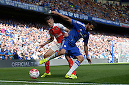 Gabriel of Arsenal tackles Diego Costa of Chelsea. Barclays Premier League match, Chelsea v Arsenal at Stamford Bridge in London on Saturday 19th September 2015.<br /> pic by John Patrick Fletcher, Andrew Orchard sports photography.