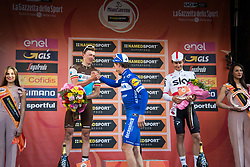 March 24, 2019 - Sanremo, Sanremo, Italy - Julian Alaphilippe (C) of the Deceuninck team, winner with Oliver Naesen of AG2R La Mondiale (L) second and Michal Kwiatkowski of Team Sky, third (R), are seen on the podium during the 110th edition of Milan - Sanremo, cycling race. (Credit Image: © Puletto  Diego/SOPA Images via ZUMA Wire)