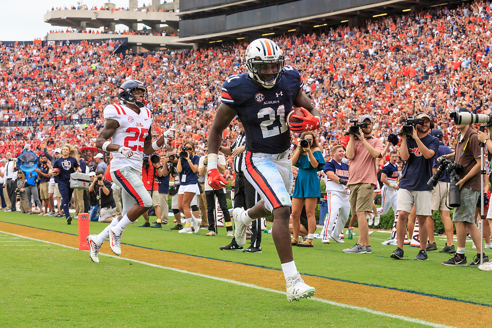 Auburn Tigers running back Kerryon Johnson (21) scores a touchdown during an NCAA football game against the Mississippi Rebels, Saturday, October 7, 2017, in Auburn, AL. Auburn won 44-23. (Paul Abell via Abell Images for Chick-fil-A Peach Bowl)