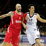 Anadolu Efes's Kerem Gonlum (R) and Olympiacos's Pero Antic (L) during their Turkish Airlines Euroleague Basketball playoffs Game 4 Anadolu Efes between Olympiacos at Abdi ipekci Arena in Istanbul, Turkey, Friday, April 19, 2013. Photo by Aykut AKICI/TURKPIX
