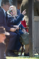 © Licensed to London News Pictures. 10/05/2017. Windsor, UK. Queen Elizabeth II watches a competition at the Royal Windsor Horse Show. The five day equestrian event takes place in the grounds of Windsor Castle. Photo credit: Peter Macdiarmid/LNP