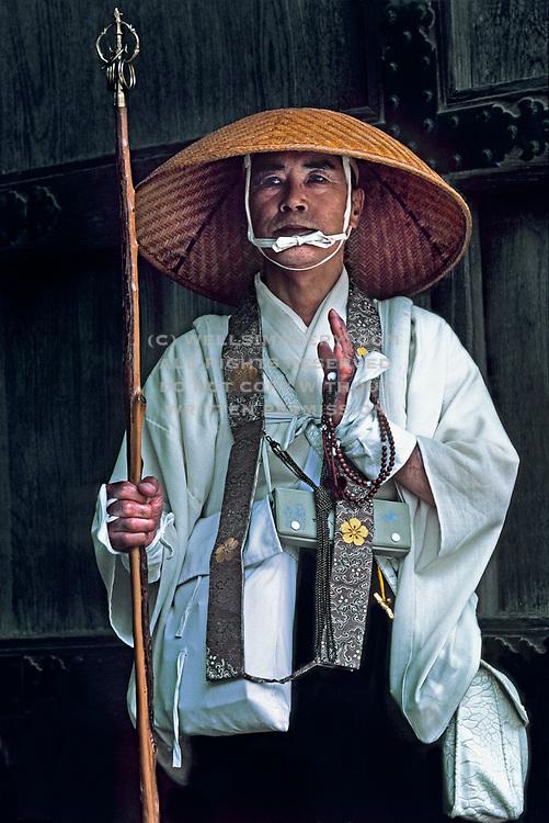 Image of a pilgrim with mala beads in Koya-san, Japan by Randy Wells
