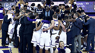 HIGH POINT, NC - JANUARY 06: Players and coaches from both teams huddled on the court after the game. The High Point University of Panthers hosted the Charleston Southern University Buccaneers on January 6, 2018 at Millis Athletic Convocation Center in High Point, NC in a Division I men's college basketball game. HPU won the game 80-59.