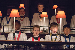 © Licensed to London News Pictures. 22/12/2014. London, UK The Choristers of St Paul's Cathedral in London rehearse today 22nd December 2014. In December, they will sing to more than 20,000 people across a series of services and concerts. On 23, 24 and 25 December alone, more than 10,000 will come through the doors for Christmas services. As some services are so popular, this year a big screen will be erected outside, allowing many thousands more to enjoy the music and worship of the season.. Photo credit : Stephen Simpson/LNP